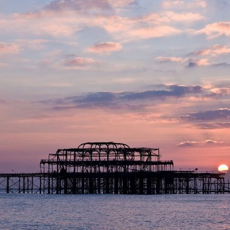 West Pier in ruins with sun setting behind it | Liam Kelly (photographer)
