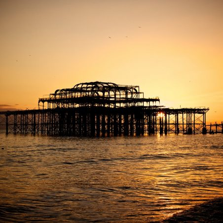 West Pier with orange sunset behind it | Rod McDonald (photographer)