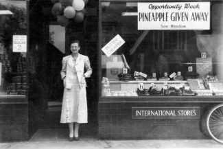 Evelyn outside the International Stores before WW2