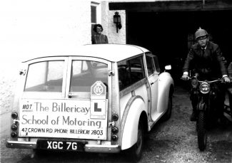 Cyril on his 1926 BSA mororcycle with his wife Elfrida looking out of the doorway behind the car.