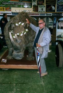 Cyril with the rhino at Sir William McAlpines. Note the additional handle to the unbrella affixed with jubilee clips to enable him to use it as a walking stick. Cyril was very proud of this.