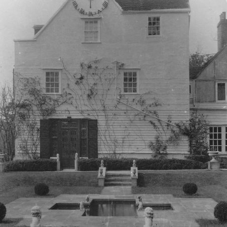 A view of the side of Stockwell Hall clearly showing the clock. Taken in 1952
