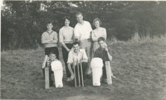 A German couple learning the joys of cricket on the field where Mayflower School now stands.   Back row: Alan Jones, the German couple, Renee Wright (the German's host).   Front Row: Graham Jones, Peter Bennett and myself. This masterclass is on the fields where Mayflower School now stands.