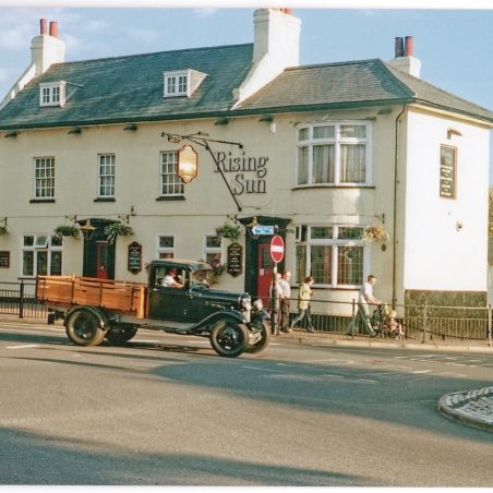 An early truck outside the Rising Sun whilst it was still a pub.