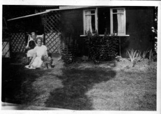 The Poplars residence showing my Mother and Grandmother at the side of house.