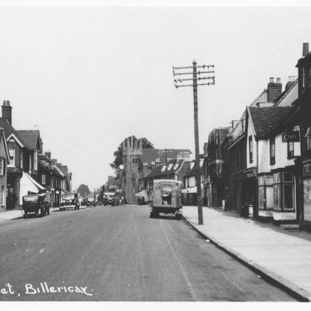 Looking north, same view, now with vehicles, possibly 1930s